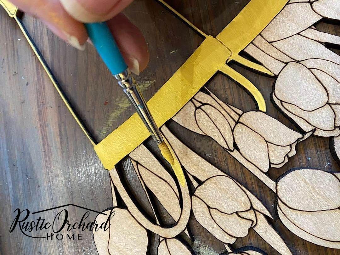 Create your own DIY Rain Boots Door Hanger with this simple tutorial!