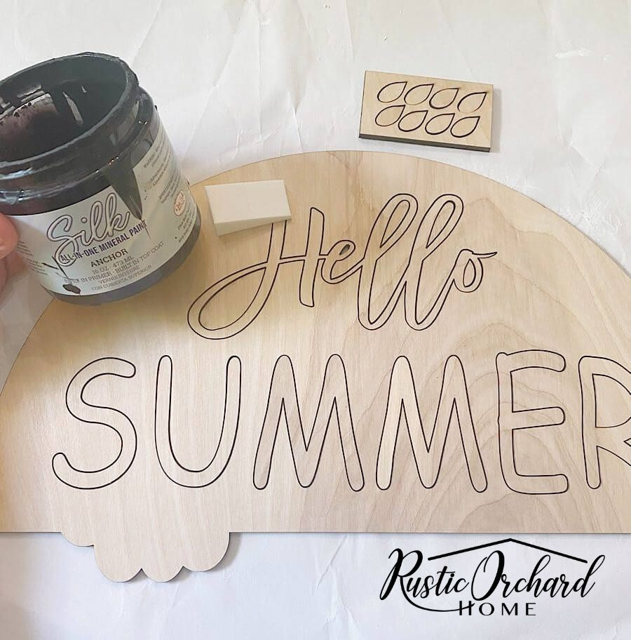 Dressing up your front door for summer is super easy when you use a DIY kit! With this easy to assemble Hello Summer Door Hanger kit, all you need to create summer door décor is paint, glue and embellishments. Let me show you how easy this one is to put together!