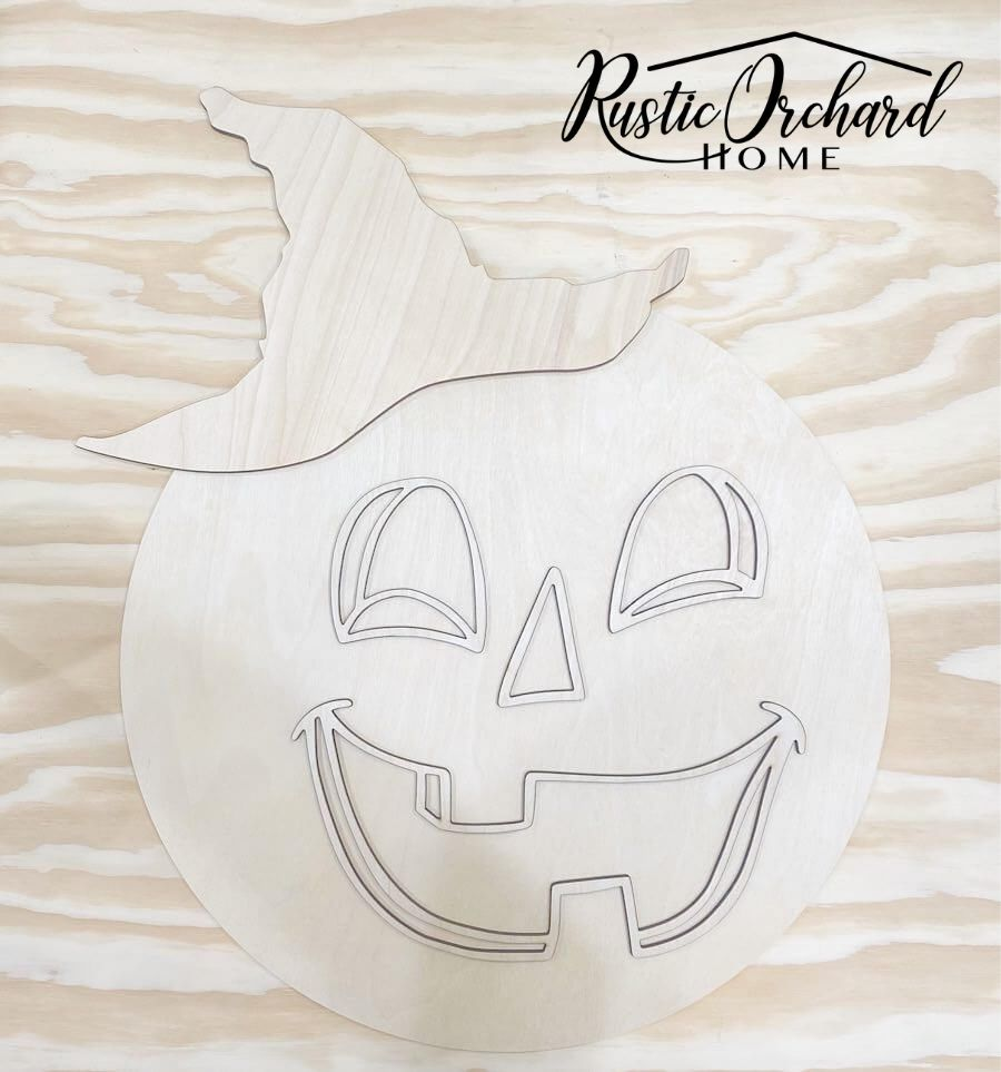 Make your own Witchy Pumpkin Door Hanger with this easy to use kit!