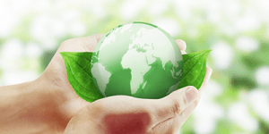 Hands holding Green globe of Earth