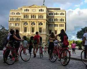 walking with bike in old havana