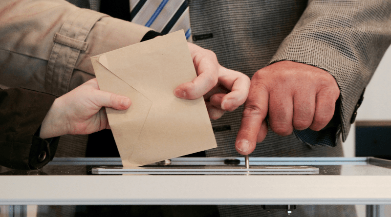 Envelope being dropped into box