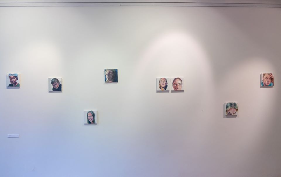 small portraits on gallery wall