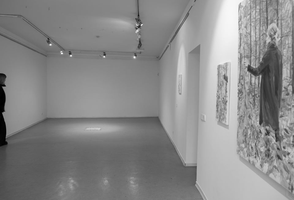 painting exhibition, artwork in the center of the floor lit by gallery lights