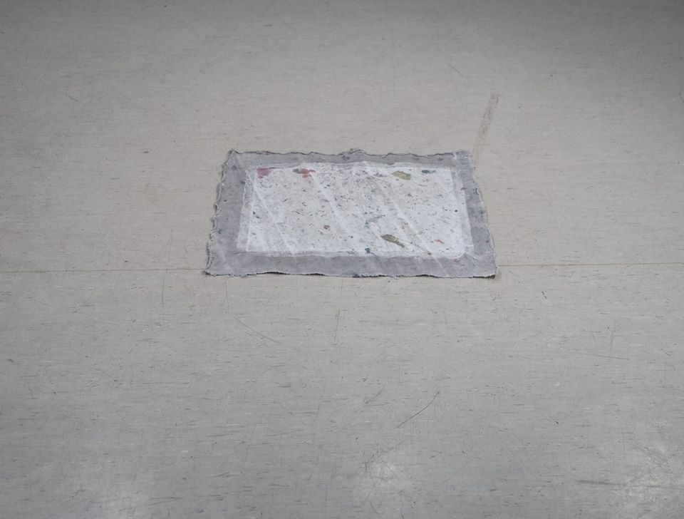 a canvas on the floor with foot marks