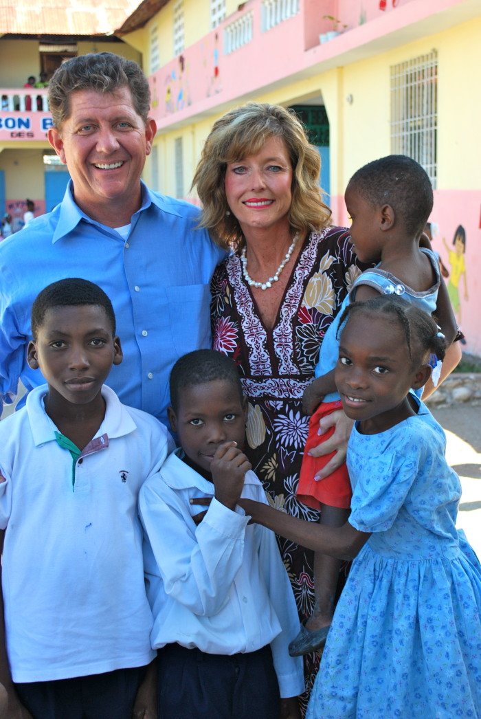 Mike and Beth Fox, founders of the GO Project, loving on some orphans