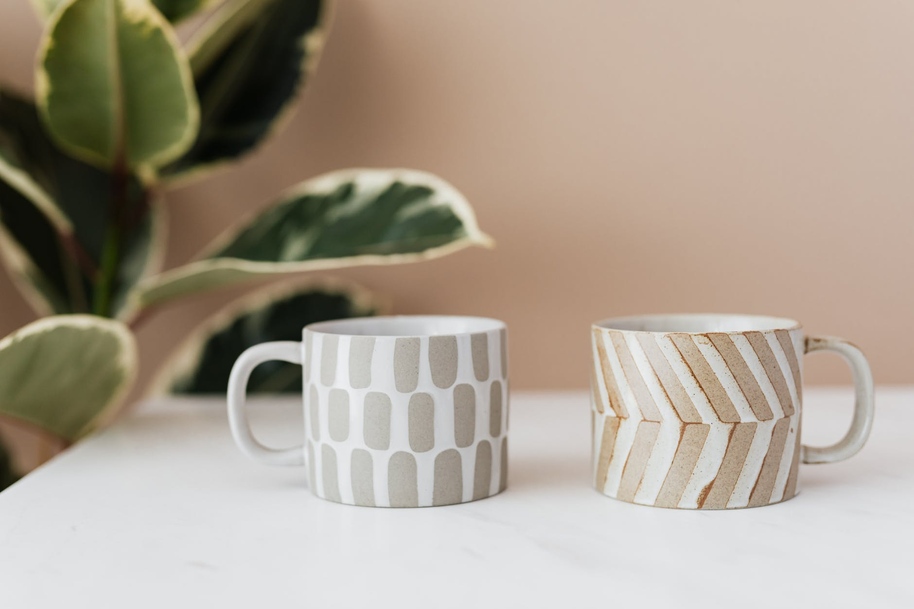 ceramic cups on marble table