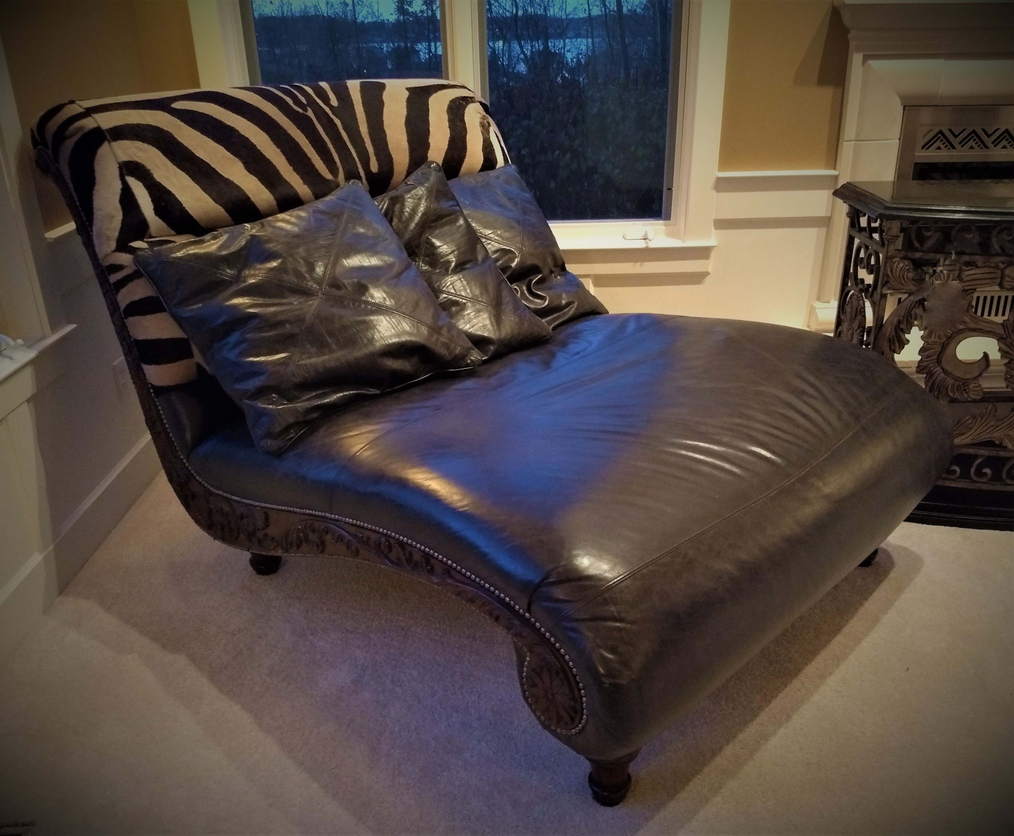 double chaise lounge leather with zebra print upholstery and 3 pillows