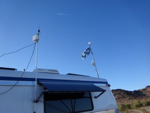 Two flagpoles setup as antenna mounts.