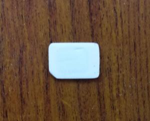 Figure 7: My SIM after completing sanding. The numbers are gone entirely and you can begin to make out the outline of the actual chip through the plastic.