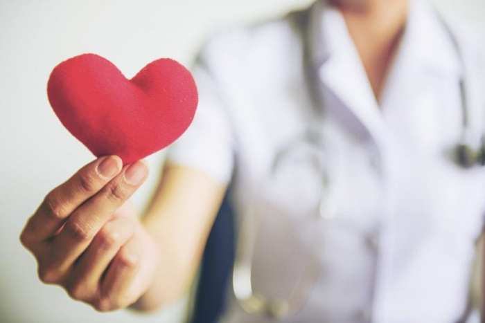 nurse holding out heart to stop bladder pain