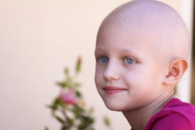 Bald Child After Chemo Treatment