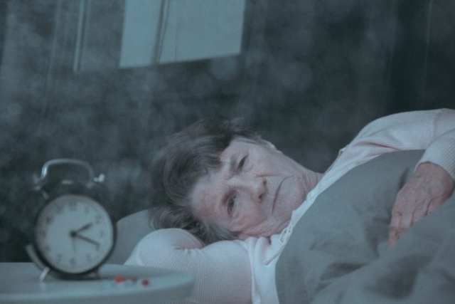 Old Woman Dementia up in middle of night