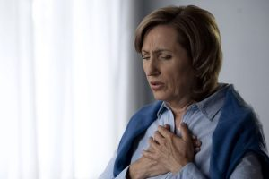 woman with difficulty breathing