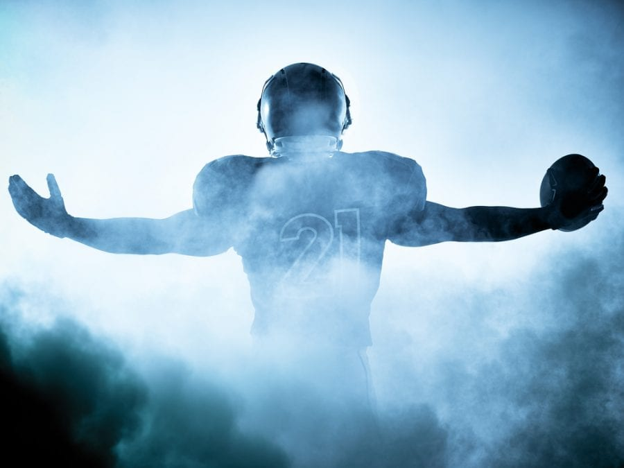 Football Player in Smoke