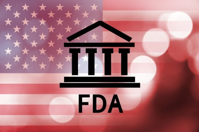 FDA Logo in front of a blurred American flag