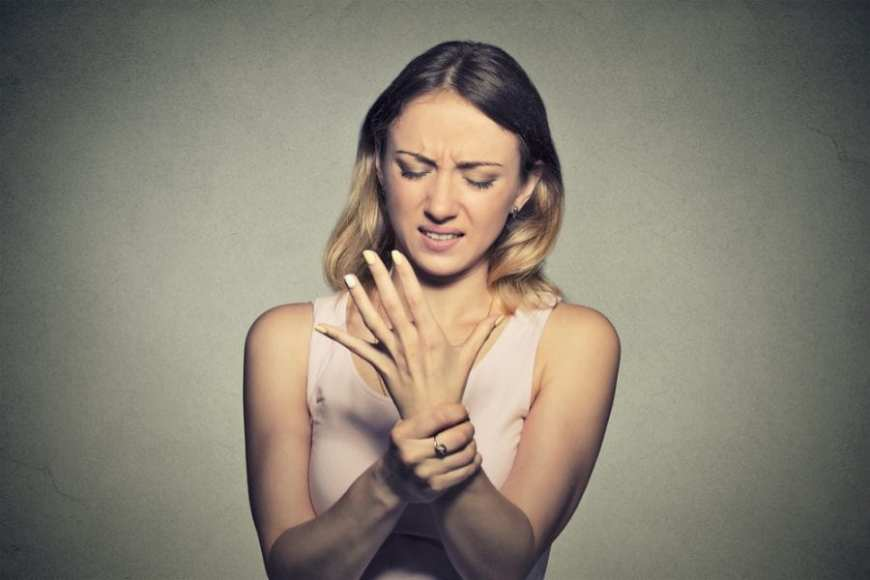 Woman with hand neuropathy nerve pain