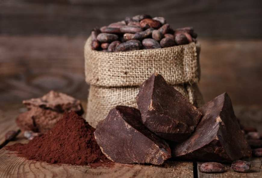 Cocoa beans in a bag and chocolate in front