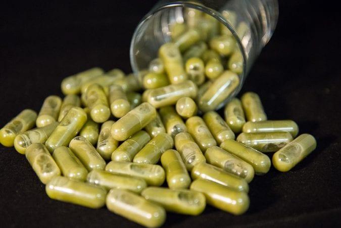 Trill's THC pills spilling from a glass far