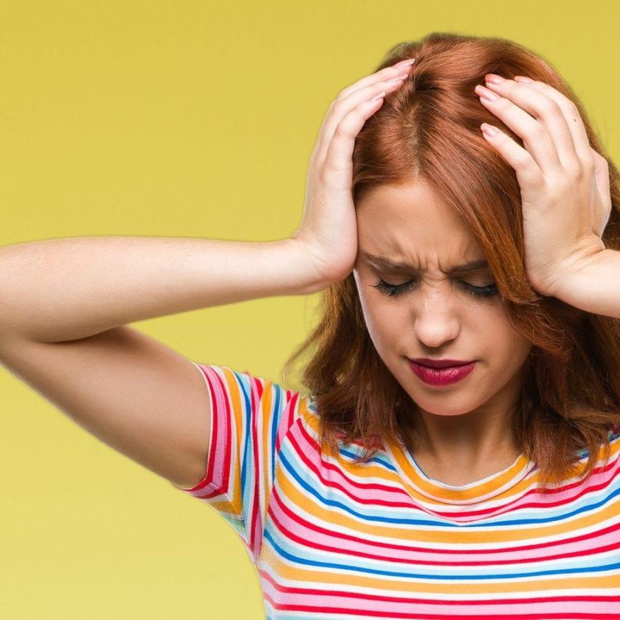 redhead with migraine headache