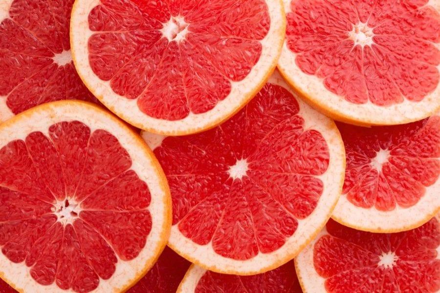 bunch of sliced grapefruit close up