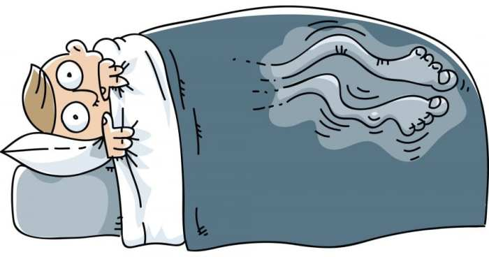 cartoon of man in bed with restless leg syndrome