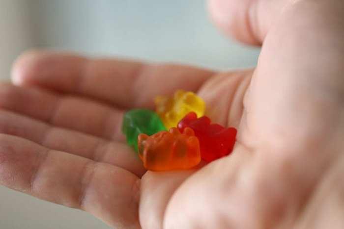 CBD gummies in man's hand