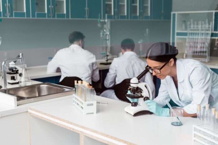 scientist at work in lab studying cannflavins or cannaflavins