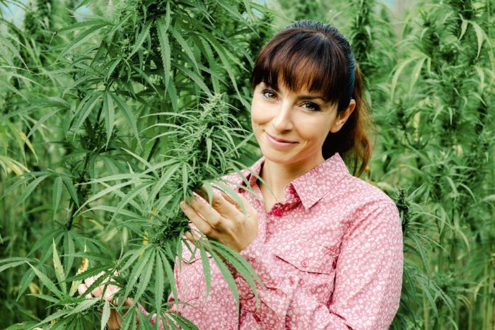woman with cannabis plants
