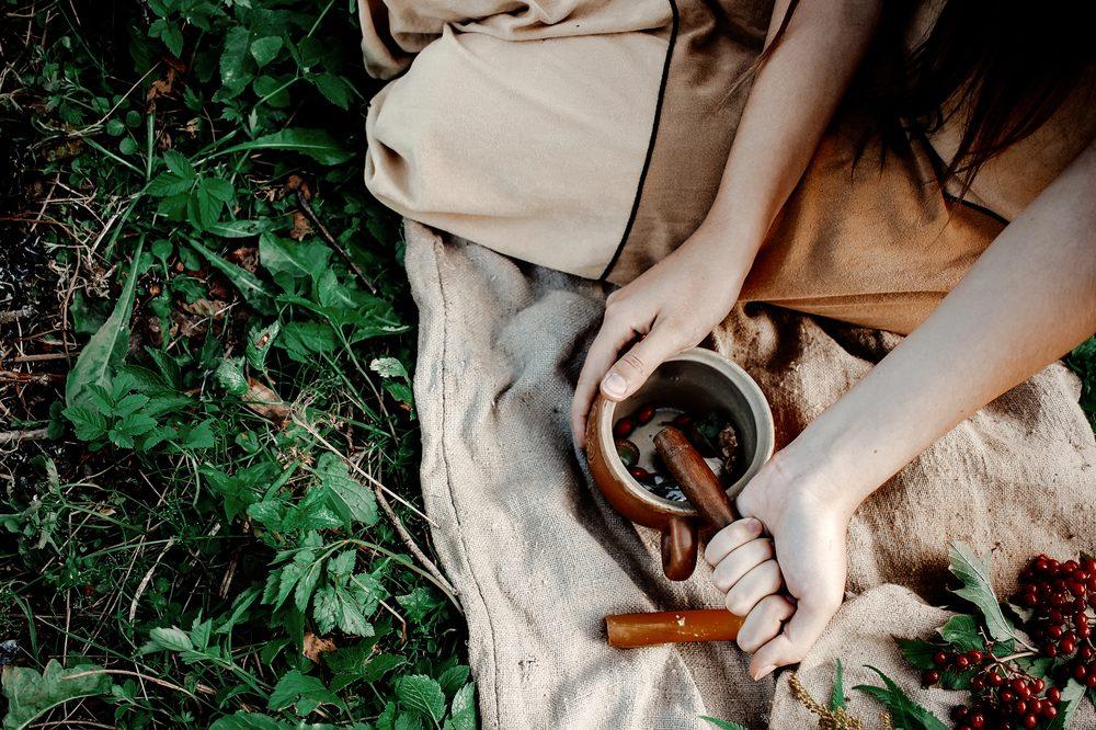 native american woman preparing traditional medicine