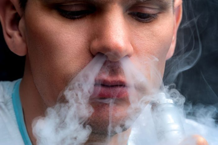 man vaping despite fact that it maybe can kill you