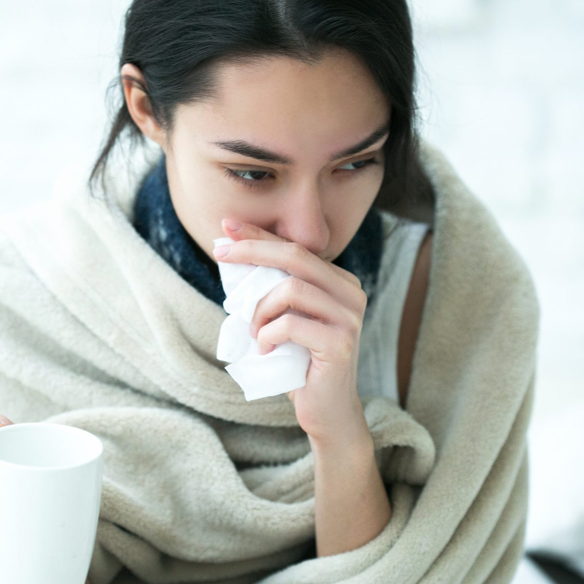 THC lozenges to help young Asian woman with cold
