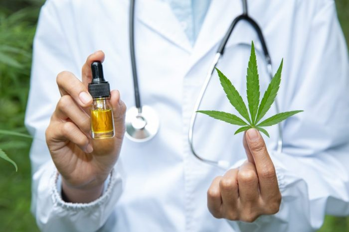 cbd cannabis oil might eb in the bottle held by this doctor