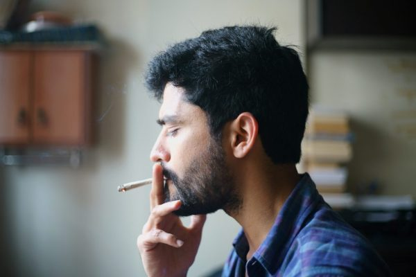 difference between recreational and medical is unimportant for this consumer being a younger man smoking cannabis facing away from the camera