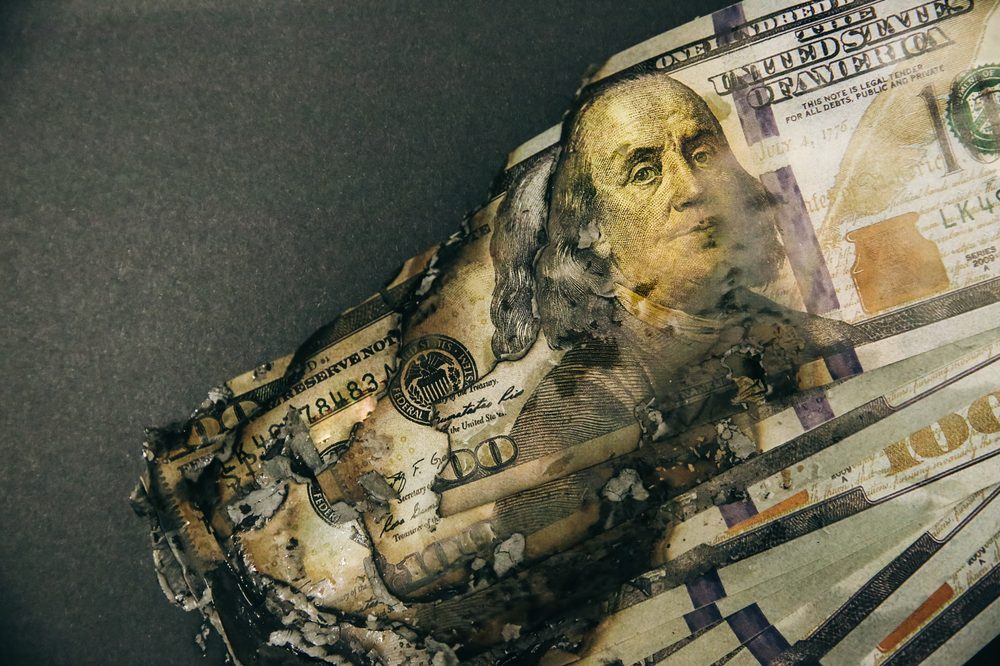 BIG PHARMA LOSING MONEY represented by burnt american money