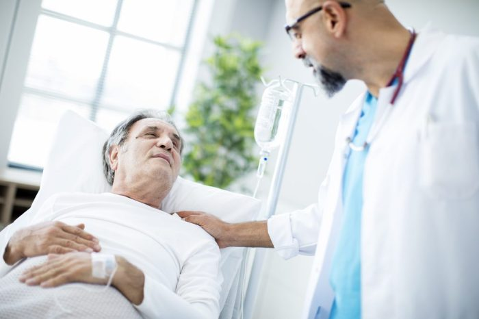 cancer in testicles concept resented by man meeting with doctor