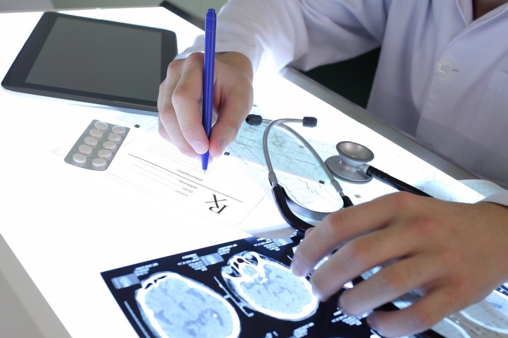 how much cbd for epilepsy represented by doctor looking at brain scans