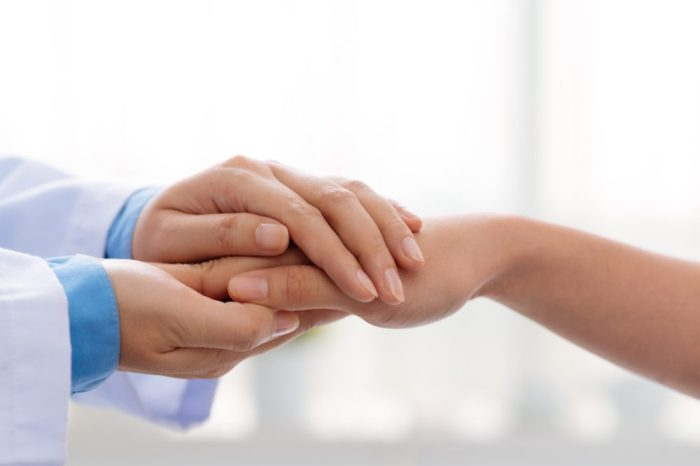 stage 4 stomach cancer shaking hands with doc