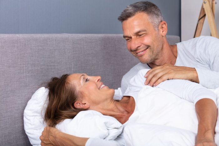 cbd lube hinted at by older couple happy laying in bed