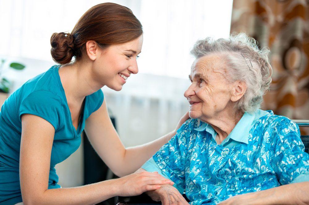 frail older adult chats with caregiver
