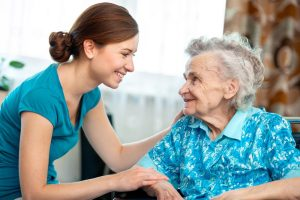frail older adult chats with caregiver