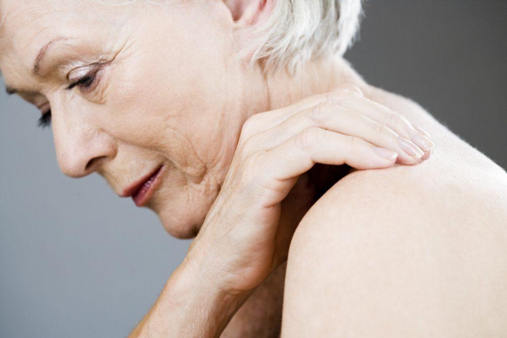 older white female applying topical pain cream