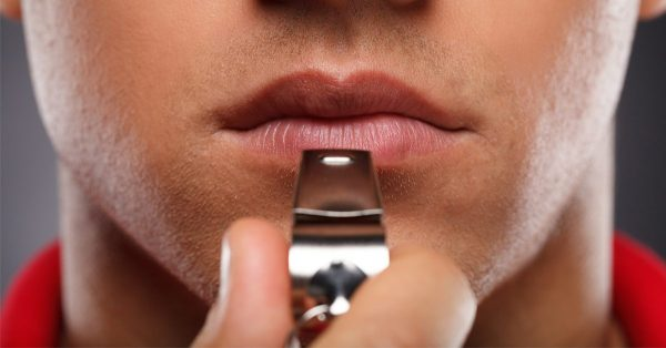 what is a whistleblower represented by male face closeup about to blow on a whistle