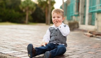 Little boy laughing at family behind the Atalaya Castle - Huntington Beach State Park