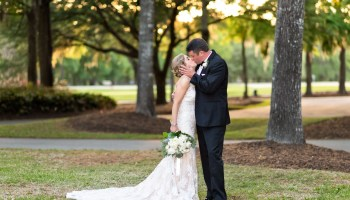 Kiss in the sunset in front of the clubhouse Pawleys Plantation