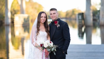 Couple with beautiful waccamaw river in the background - Conway River Walk