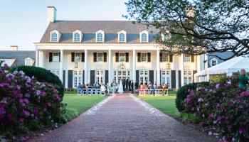 Sunset ceremony on the lawn facing the clubhouse - Pine Lakes Country Club