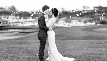 Bride touching groom's face in black and white - Grande Dunes - Myrtle Beach