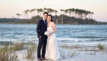 Just married couple at sunset with an island in the background - Cherry Grove Point - North Myrtle Beach