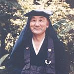 Photo of Yasutani roshi doing Takuhatsu
